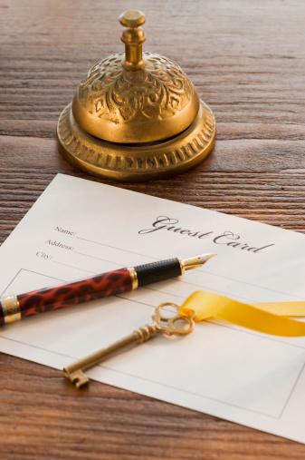 Hotel Reception「Guest registry card, pen, key and bell on table」:スマホ壁紙(4)
