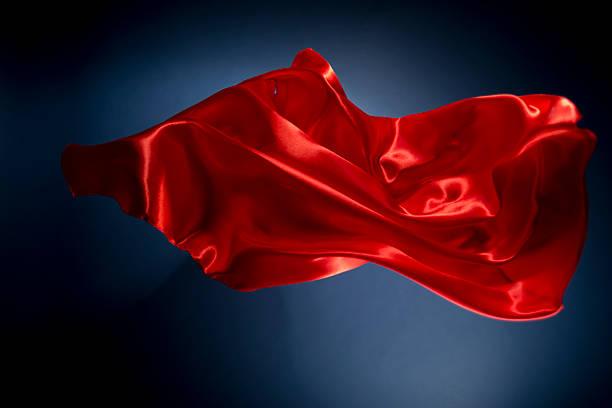 Floating red silk on a dark blue background:スマホ壁紙(壁紙.com)