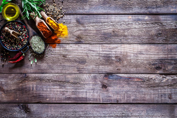 Spices and herbs on rustic wood kitchen table:スマホ壁紙(壁紙.com)