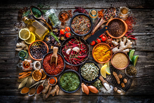 Spices and herbs shot from above on rustic wooden table:スマホ壁紙(壁紙.com)