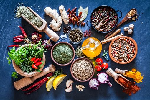 Bay Leaf「Spices and herbs on dark bluish kitchen table」:スマホ壁紙(11)