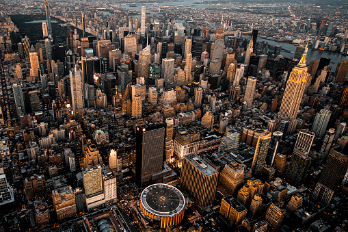 Hudson River Park「Midtown Manhattan skyline with Madison Square Garden and Empire State Building taken from a helicopter at golden hour」:スマホ壁紙(3)
