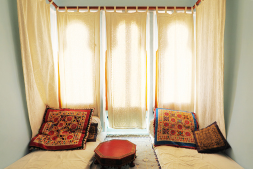 Rajasthan「colourful bright living room with white curtains and mattress India」:スマホ壁紙(5)
