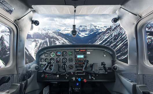 Propeller Airplane「View past plane cockpit to snowy mountains」:スマホ壁紙(2)