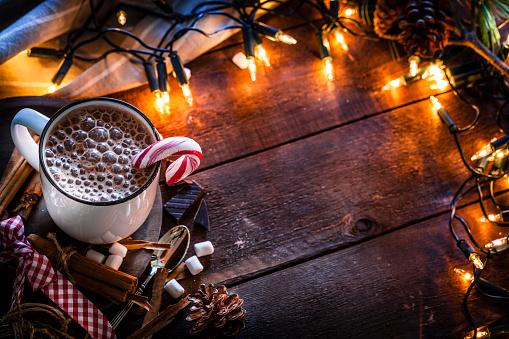 Christmas Lights「Homemade hot chocolate mug with marshmallows on rustic wooden Christmas table」:スマホ壁紙(13)