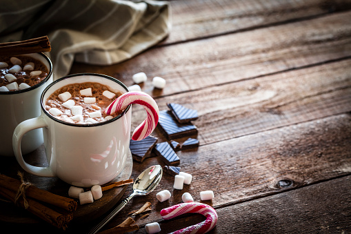 Candy Cane「Homemade hot chocolate mug with marshmallows on rustic wooden Christmas table」:スマホ壁紙(5)