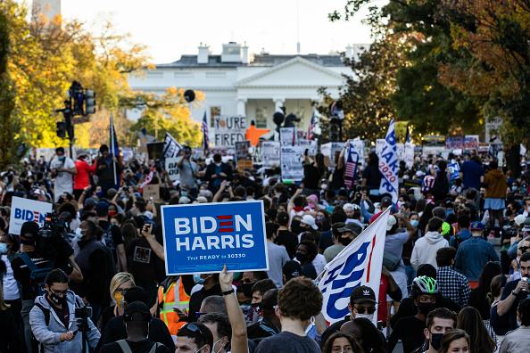 Celebration「Supporters Of Joe Biden Celebrate Across The Country, After Major Networks Project Him Winning The Presidency」:写真・画像(14)[壁紙.com]