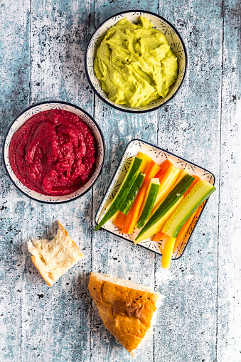 Crudite「Bowls of beetroot hummus and avocado hummus, crudites and flat bread」:スマホ壁紙(17)