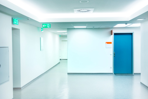 Surrounding Wall「Empty white Hospital corridor with a blue door」:スマホ壁紙(10)