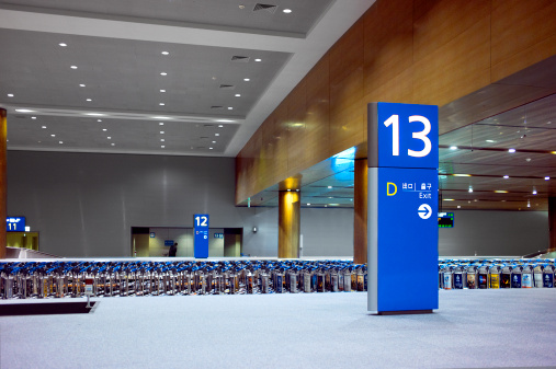 Number 13「A line of luggage carts at an airport terminal.」:スマホ壁紙(19)