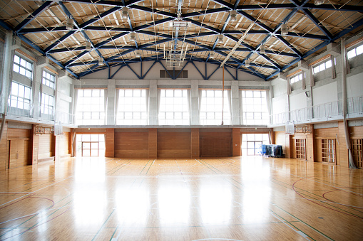 School Building「Japanese high school. An empty school gymnasium. Basketball court markings」:スマホ壁紙(4)