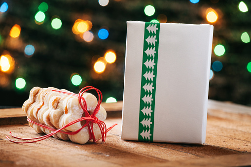 Sweets「Stack of Christmas cookies and wrapped Christmas present」:スマホ壁紙(15)