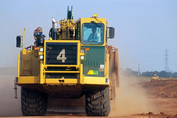 Yellow「AMPL Caterpillar grader. M6 toll road construction, Birmingham, United Kingdom.」:写真・画像(2)[壁紙.com]
