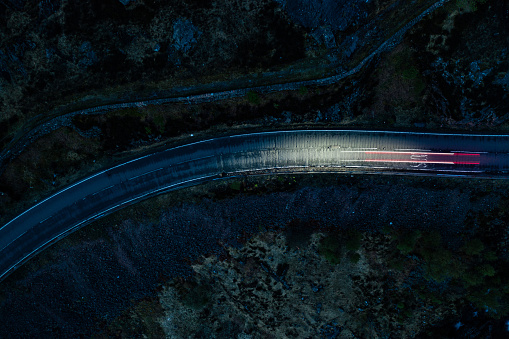 Light Trail「Light trails in the night on a remote road in mountains」:スマホ壁紙(11)