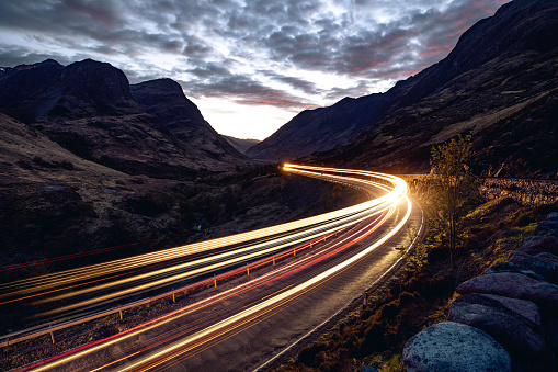Light Trail「Light trails in the night on a remote road in mountains」:スマホ壁紙(7)