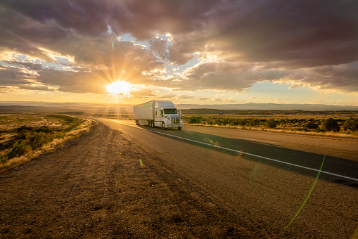 Freight Transportation「Semi Truck Heading East Bound With a Beautiful Sunset」:スマホ壁紙(19)