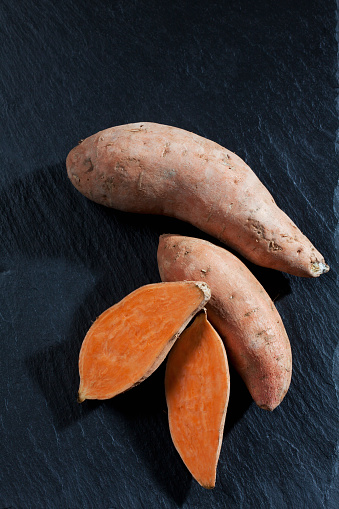 Sweet Potato「Whole and sliced sweet potatoes on slate」:スマホ壁紙(7)