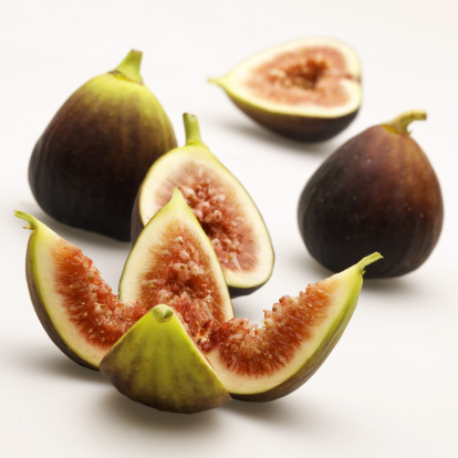 Fig「Whole and sliced figs against white」:スマホ壁紙(14)