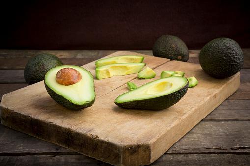 Avocado「Whole and sliced avocado on wooden board」:スマホ壁紙(12)