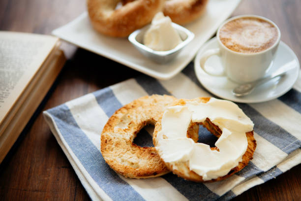 Montreal style bagels on a plate with cream cheese and coffee:スマホ壁紙(壁紙.com)