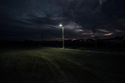 Cloud - Sky「Street lamp at edge of dirt parking lot.」:スマホ壁紙(5)