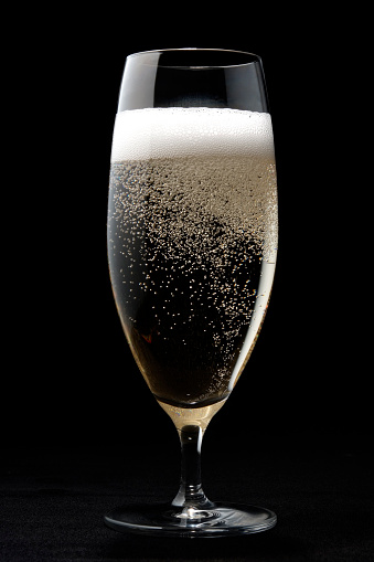 Champagne Flute「Isolated shot of Champagne glass with bubbles on black background」:スマホ壁紙(3)