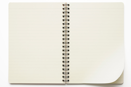 Diary「Isolated shot of opened spiral notebook on white background」:スマホ壁紙(1)