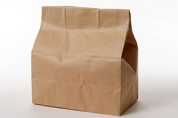 Isolated shot of closed brown paper bag on white background:スマホ壁紙(壁紙.com)