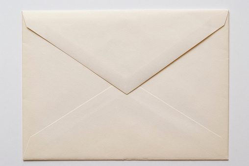 Envelope「Isolated shot of closed an old envelope on white background」:スマホ壁紙(0)