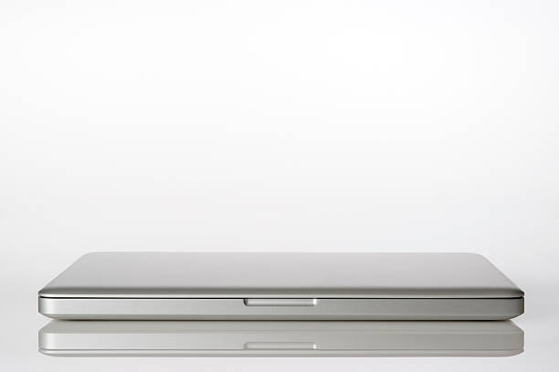 Isolated shot of closed laptop on white background:スマホ壁紙(壁紙.com)