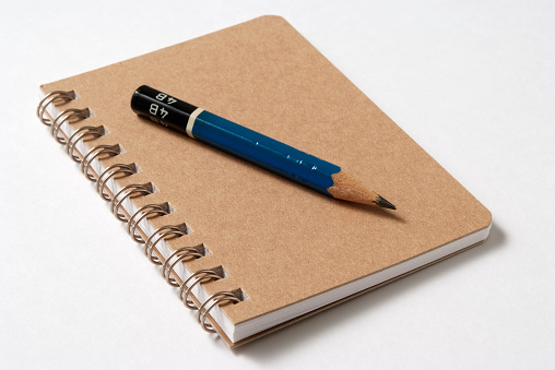 Pen「Isolated shot of spiral notebook with pencil on white background」:スマホ壁紙(12)