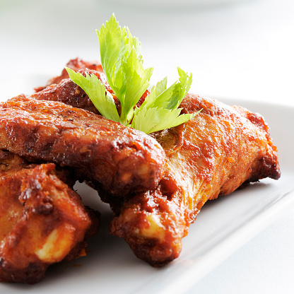Animal Wing「A white plate full of spicy chicken wings」:スマホ壁紙(1)