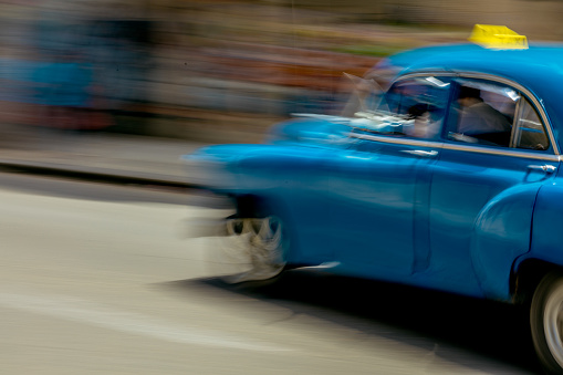 Unrecognizable Person「On a street in Havana, a man is driving an old but well maintained blue American car.」:スマホ壁紙(16)