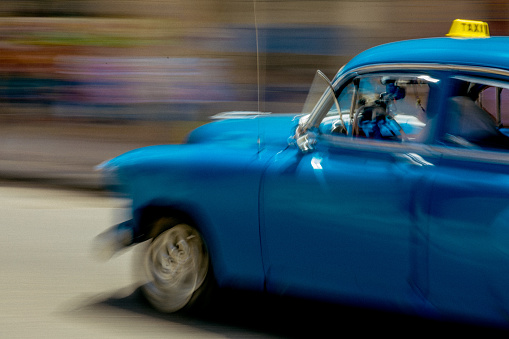 Unrecognizable Person「On a street in Havana, a man is driving an old but well maintained blue American car.」:スマホ壁紙(18)