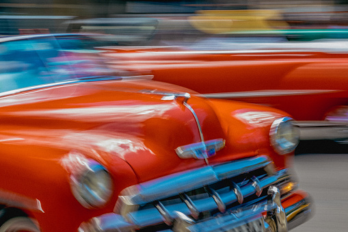 Unrecognizable Person「On a street in Havana, an old but well maintained bright red American car is going by.」:スマホ壁紙(17)