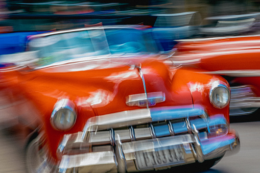 Unrecognizable Person「On a street in Havana, an old but well maintained bright red American car is going by.」:スマホ壁紙(9)