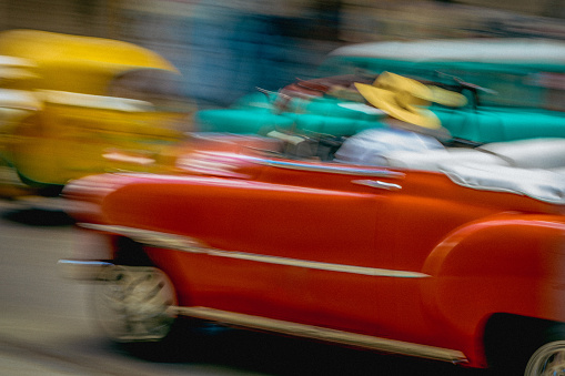 Unrecognizable Person「On a street in Havana, an old but well maintained bright red American car is going by.」:スマホ壁紙(14)