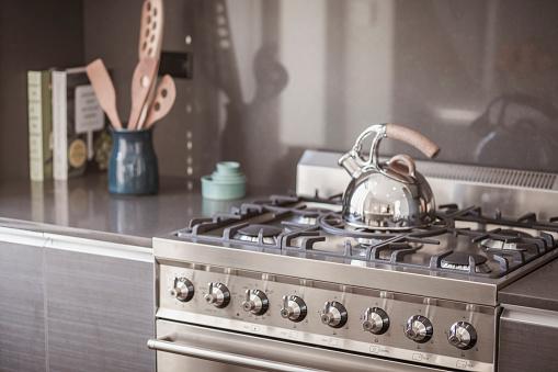 Teapot「Kettle on stainless steel stove in modern kitchen」:スマホ壁紙(6)