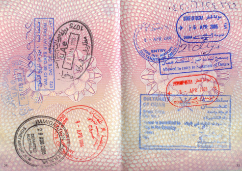 English Culture「An opened passport with entry stamps on both pages」:スマホ壁紙(19)