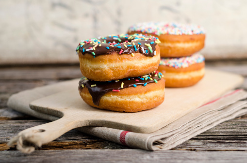 Granule「Kitchen board with four doughnuts decorated with sugar granules」:スマホ壁紙(14)