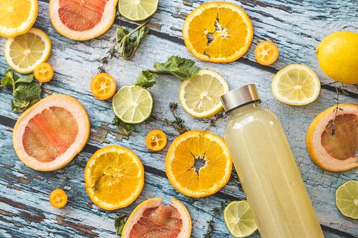 Lemon Soda「Bottle of lemonade and slices of citrus fruit」:スマホ壁紙(9)