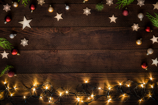 Illuminated「Christmas decoration with copy space on a rustic wooden table」:スマホ壁紙(19)