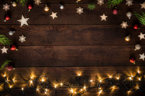 Christmas decoration with copy space on a rustic wooden table:スマホ壁紙(壁紙.com)
