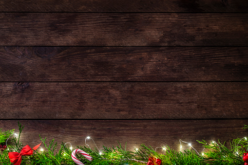 Plank - Timber「Christmas decoration with copy space on a rustic wooden table」:スマホ壁紙(1)