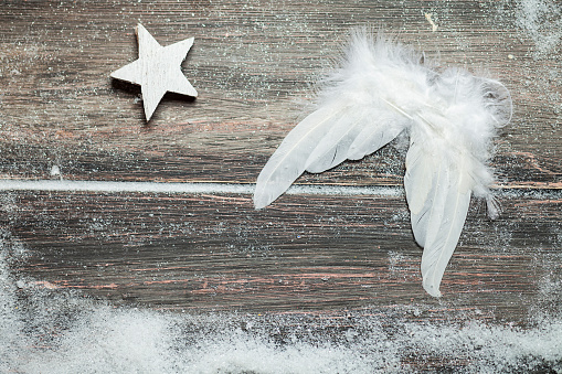 Fake Snow「Christmas decoration, angel wings on wood, star, artificial snow, copy space」:スマホ壁紙(1)