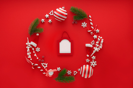 Candy Cane「Christmas Decoration on red background with copy space」:スマホ壁紙(12)