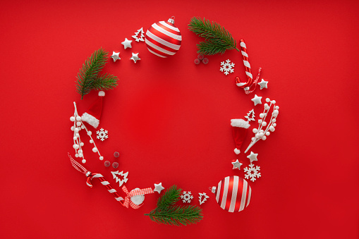 Candy Cane「Christmas Decoration on red background with copy space」:スマホ壁紙(8)