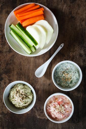 Kohlrabi「Tomato dip, avocado dip and herb dip and row food」:スマホ壁紙(18)