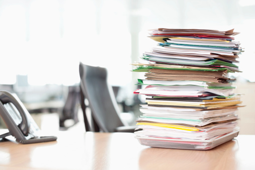 Paperwork「Stack of files on tray next to telephone at office desk」:スマホ壁紙(14)
