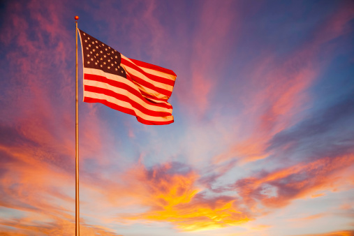 Fourth of July「American Flag glows in the sunset. (P)」:スマホ壁紙(9)